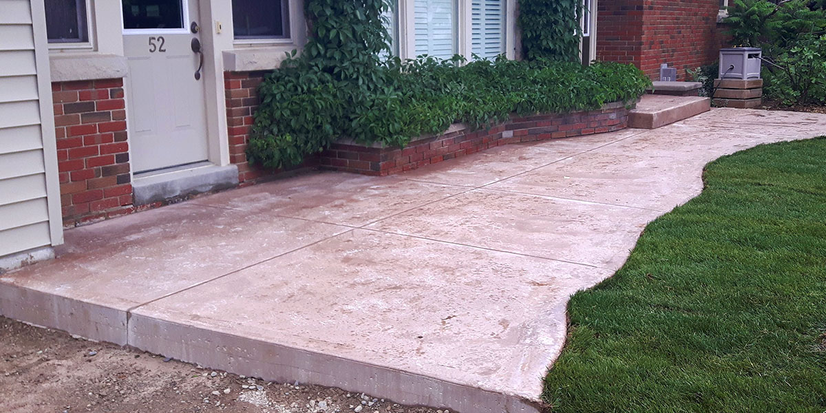 Stamped concrete patios sidewalks and driveways lester for Removing concrete walkway