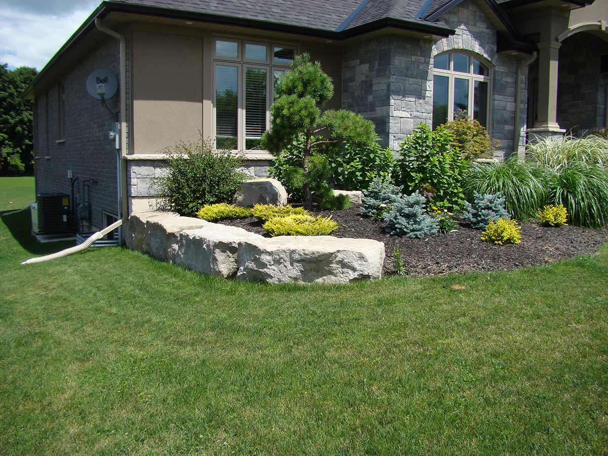 Armour stone landscaping ideas attractive design for Stone landscaping ideas