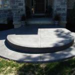 A new coloured concrete sidewalk.