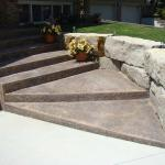 A new concrete driveway with decorative, coloured concrete steps.
