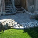 New patio with river rock and Armour Stone.