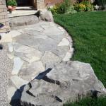Stone sidewalk with Armour Stone.